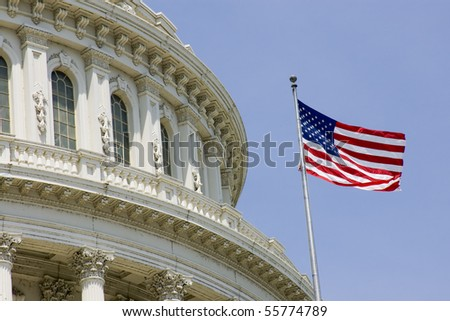 US Capitol dome detail with flag - stock photo