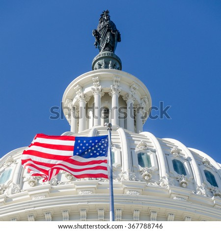 US Capitol Dome detail with waving National flag - stock photo