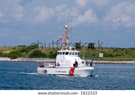 US Coast Guard boat on security patrol in sea port - stock photo