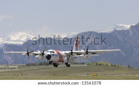 US Coast Guard C-130 taking off - stock photo