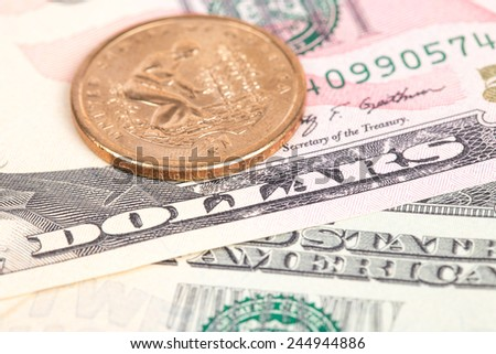 US coins on US banknotes close up - stock photo