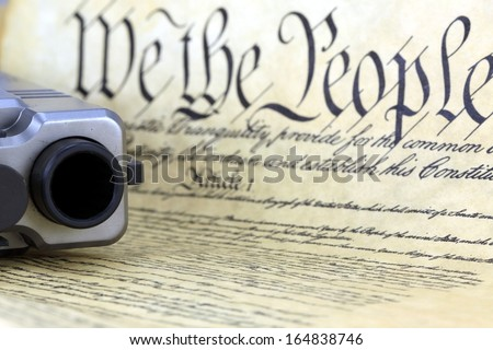 US Constitution with Hand Gun - Right To Keep and Bear Arms - stock photo
