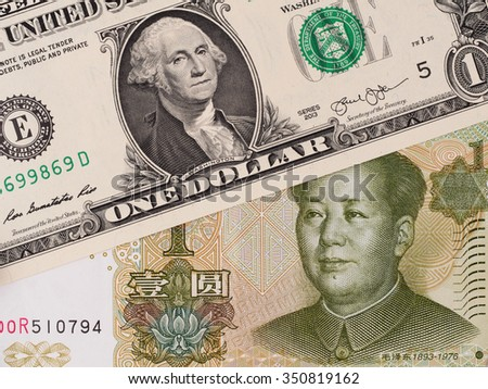 US dollar and chinese yuan banknotes, currency exchange, money closeup - stock photo