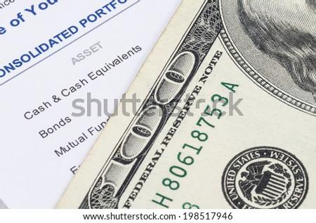 us dollar banknote on the investment portfolio - stock photo