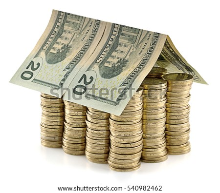 US Dollar banknotes as a roof at the top of stack of coins as concept related to real estate business.