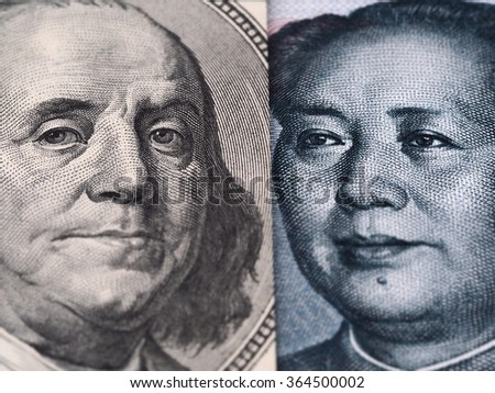 US dollar bill (Ben Franklin) and Chinese yuan banknote (Mao Zedong) close up macro, united states and China money closeup