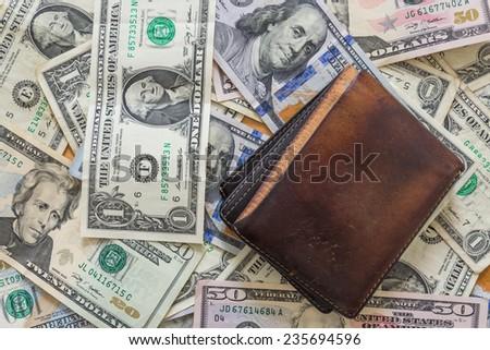 US dollar bills background wallet - stock photo