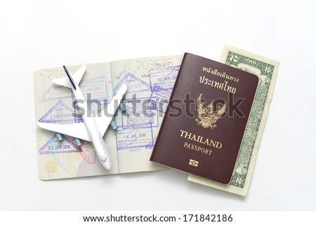 us dollar bills with Thailand passport on the old book  - stock photo