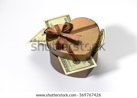 US dollar currency notes in the heart shape gift box. Valentine's Day cash reward or gift concept. - stock photo