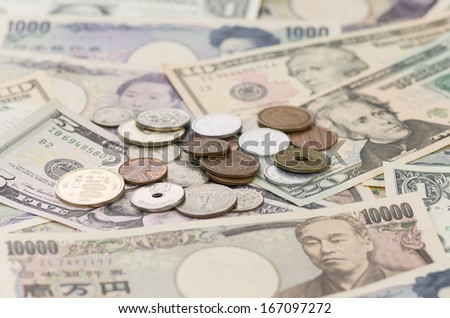 US Dollars and Japanese Yen - stock photo