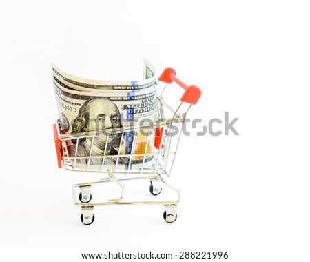 US dollars banknote with shopping cart isolated on white background. Concept of currency, business, finance and online shopping/e-commerce. Copy space. - stock photo
