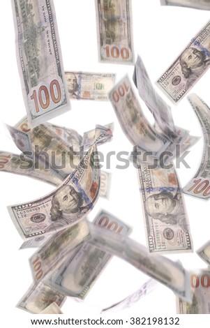Us dollars falling on white background. - stock photo
