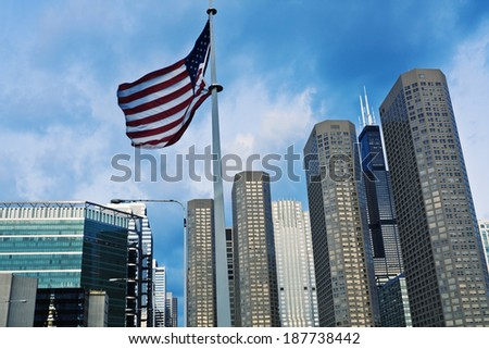 US flag and Presidential Towers in Chicago, IL. - stock photo