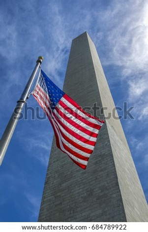 US flag and Washington Monument in DC.