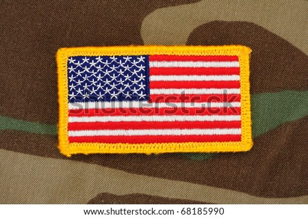 US flag patch on woodland camo background - stock photo
