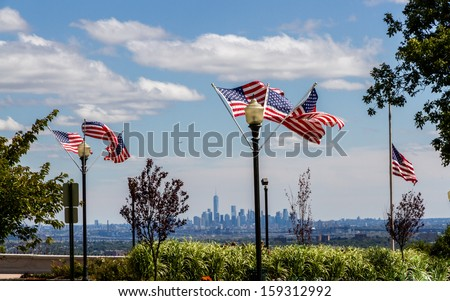 US Flags at the Eagle Rock Reservation in New Jersey with the Skyline of Lower Manhattan and the completed One World Trade Center tower in the background - stock photo