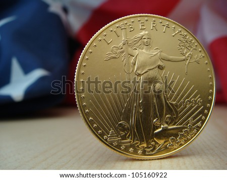 US $50 Gold Eagle Obverse Standing On Right with US Flag in Back Ground - stock photo