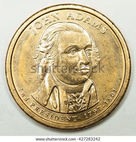 US Gold Presidential Dollar Featuring John Adams - stock photo