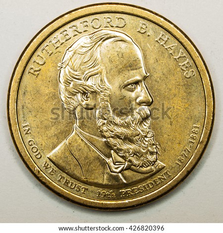 US Gold Presidential Dollar Featuring Rutherford B Hayes - stock photo