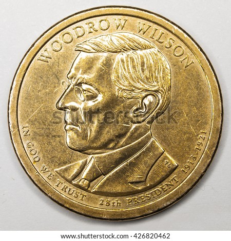 US Gold Presidential Dollar Featuring Woodrow Wilson - stock photo