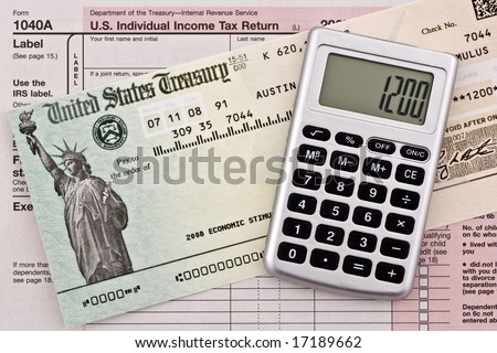 US government stimulus refund check with calculator and tax form 1040a. Numbers have been altered and name removed. - stock photo