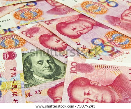US Hundred dollar bill surrounded by Chinese Yuan - stock photo