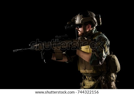 US marine corps soldiers with rifles. shot in studio. isolated on black background.