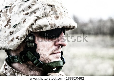US marine in the desert half-turned to the camera - stock photo