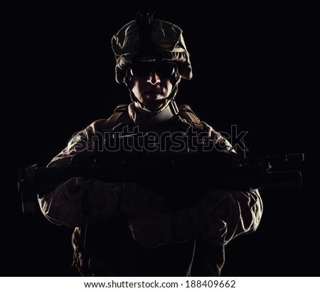 US marine with the rifle on black background - stock photo