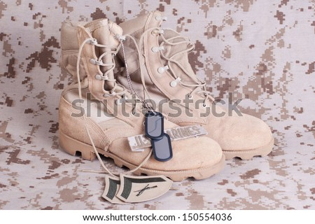 US Marines concept with firearms, boots and camouflaged uniform - stock photo