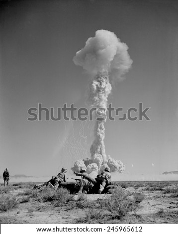 US Marines in battle exercises during atomic bomb testing. Over 2,000 soldiers participated in BEE Shot on March 22, 1955 at Yucca Flat, Nevada. - stock photo