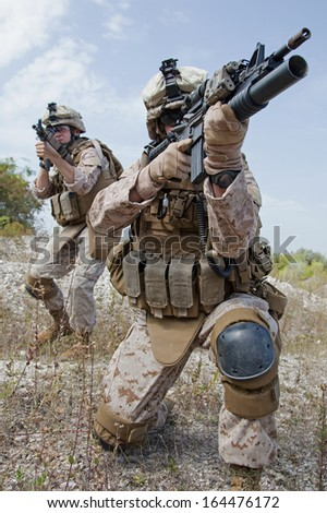 US marines in the mountains during the military operation - stock photo