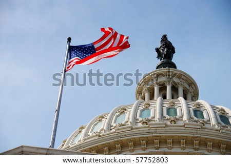 US national flag flying over Capitol Hill Building in Washington DC - stock photo