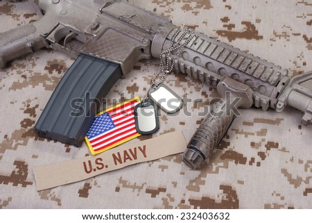 us navy uniform and weapon concept background - stock photo