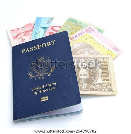 US passport and multinational currencies on a white background