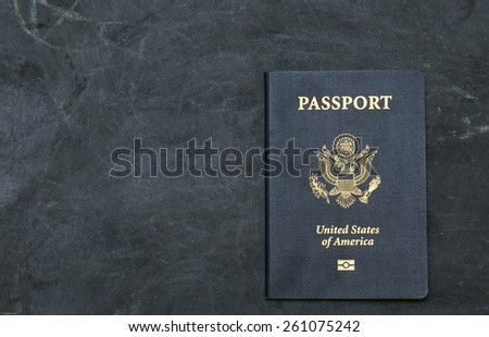US passport on black background. American citizenship. Traveling around the world. - stock photo