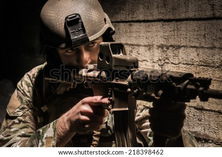 US ranger behind concrete obstacle - stock photo