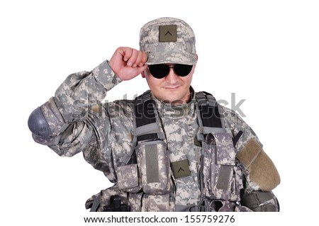 US soldier adjusts his cap on white background - stock photo