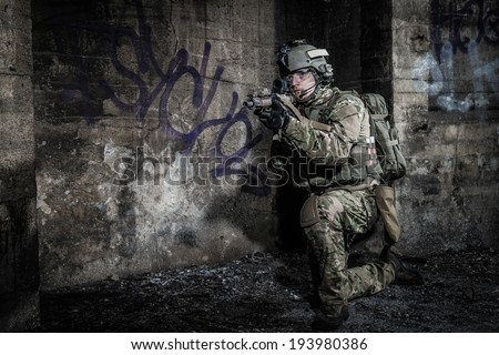 us soldier at night in urban area - stock photo