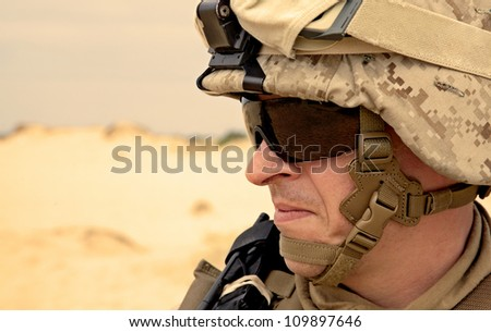 US soldier in the desert half-turned to the camera