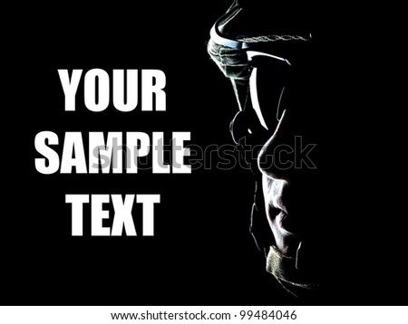 US soldier on the black background with the lot of copyspace - stock photo