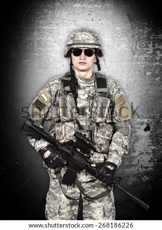US soldier with rifle isolation on gray background - stock photo