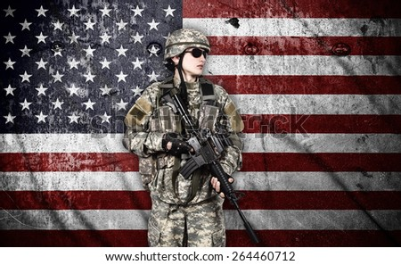 US soldier with rifle on usa flag background - stock photo