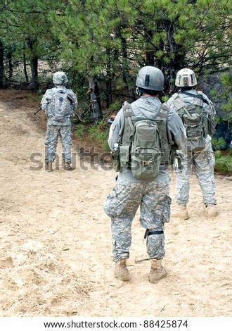 us soldiers with assault rifles on patrol