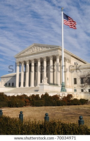 US Supreme Court Building with United States Flag - stock photo
