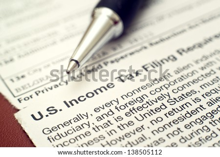 US tax form 1042, foreign person's US source income subject to Withholding - stock photo