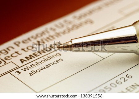 US tax form 1042, foreign person's US source income subject to Witholding - stock photo