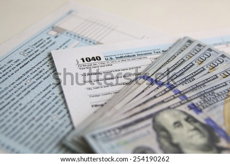 US Tax Form 1040 with new 100 US dollar bills. business concept - stock photo