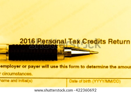US tax form with pen - stock photo