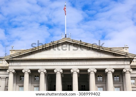 US Treasury Department Front Columns and Flag Pennsylvania Ave Washington DC.  The Treasury is located next to the White House - stock photo
